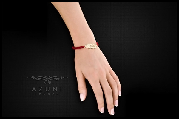 Bracelet cordon plume Santa Fe, dorure or 18K, rouge Azuni, packaging