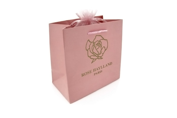 Boucles d'oreilles goutte perle de verre Amy rouge Rose Haylland, packaging